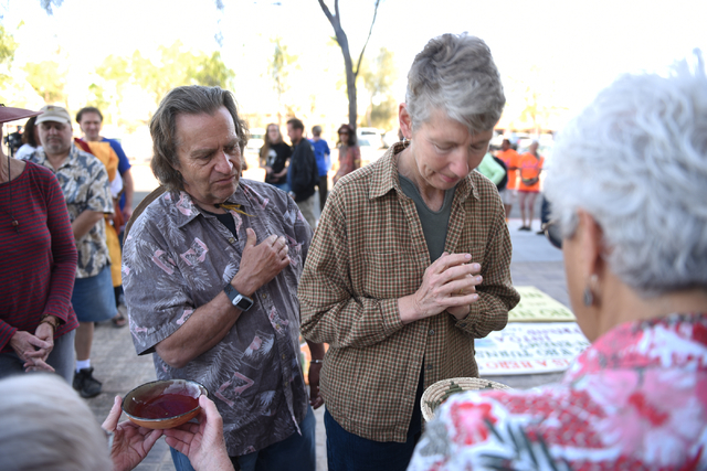 Peace walkers Mark Kelso and Carolyn Metzler are blessed with prayer before they and other peace walkers begin their 60-mile pilgrimage starting from the National Atomic Testing Museum in Las Vega ...