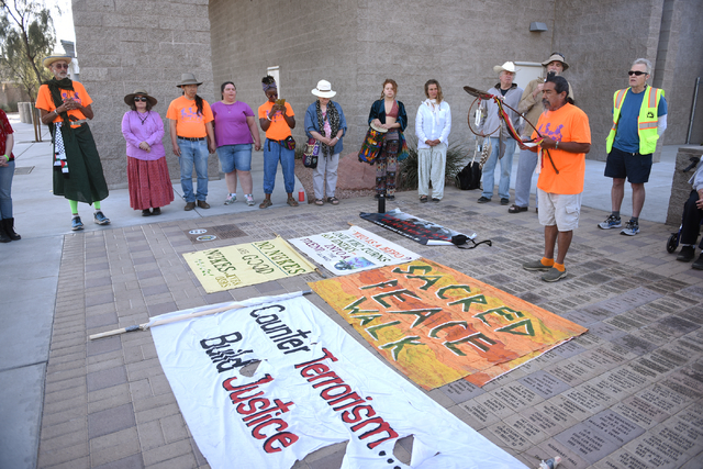 Willie Fragosa, second from right, blesses the peace walkers and their journey using sage and a prayer stick before they begin their 60-mile pilgrimage starting from the National Atomic Testing Mu ...