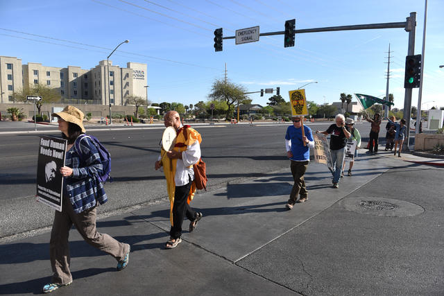 Peace walkers begin their 60-mile pilgrimage starting from the National Atomic Testing Museum in Las Vegas to the Nevada Test Site during the annual Sacred Peace Walk on Sunday, March 20, 2016. Ma ...