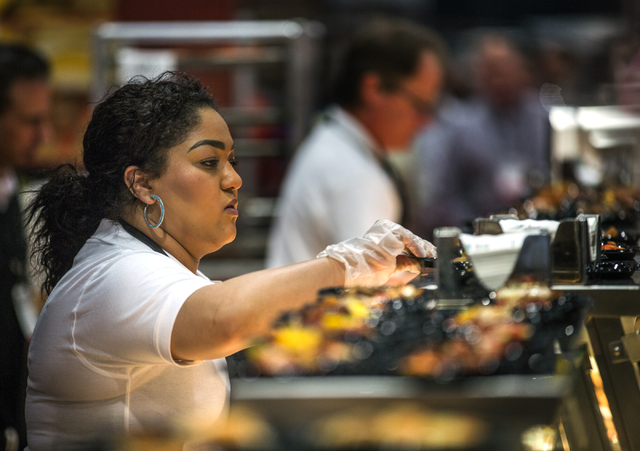 Amber Anderson serves Fontanini pizza during  the Pizza Expo at the Las Vegas Convention Center on Tuesday, March 8, 2016. Jeff Scheid/Las Vegas Review-Journal Follow @jlscheid