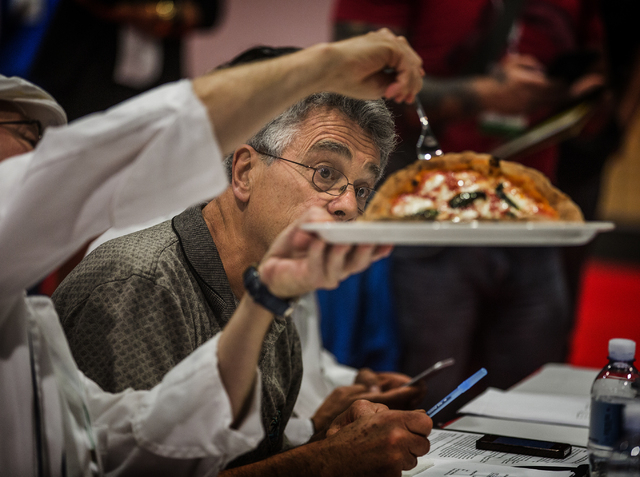 Raymond Bar looks at a pizza crust while judge the Napoletana division competition during the Pizza Expo at  the Las Vegas Convention Center on Tuesday, March 8, 2016. Jeff Scheid/Las Vegas Review ...