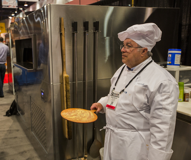 Pizza maker Marty Bacon waits for a crust in the ProLuxe booth during the Pizza Expo at  the Las Vegas Convention Center on Tuesday, March 8, 2016. Jeff Scheid/Las Vegas Review-Journal Follow @jls ...