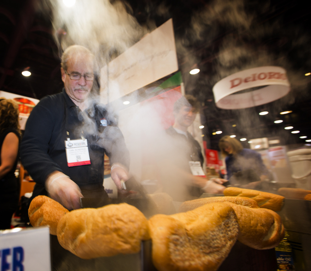 Carl Scheifele makes Philadelphia style chicken cheesesteaks at the Charles Ritter booth during the Pizza Expo at the Las Vegas Convention Center on Tuesday, March 8, 2016. Jeff Scheid/Las Vegas R ...