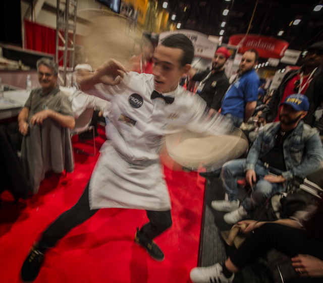 Scott Volpe with Fiamme Pizza Napoletana in Tucson, Ariz. spins rubber pizza crusts during the Pizza Expo at the Las Vegas Convention Center on Tuesday, March 8, 2016. Jeff Scheid/Las Vegas Review ...