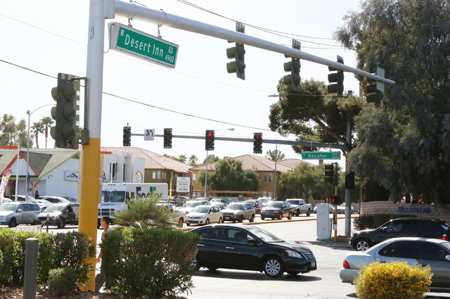 A Las Vegas police officer was dragged by a vehicle during a traffic stop at the intersection of Desert Inn Road and S. Decatur Boulevard  Wednesday, March 16, 2016. Police attempted to stop a veh ...