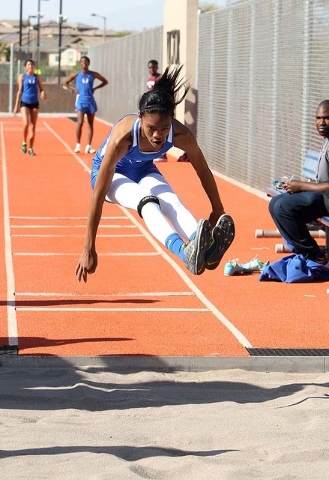 Bishop Gorman High School's Vashti Cunningham competes in the long jump during a meet with Cimarron Memorial High School at Gorman in Las Vegas, Tuesday, April 9, 2013.  (Jerry Henkel/Las Vegas Re ...