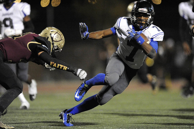 Desert Pines sophomore running back Isaiah Morris sidesteps a tackle attempt by Faith Lutheran's Trevor Driscoll during the teams' Division I-A state quarterfinal Nov. 7. (Josh Holmberg/Las Ve ...