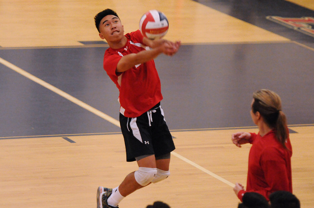 Las Vegas' T.J. Esporas (2) saves the ball during the Sunrise Region boys volleyball championship match against Valley on Friday. Esporas had 15 kills and 16 digs as Las Vegas won 3-2. (Erik Verdu ...