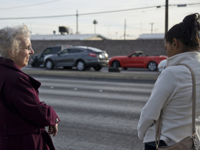 Carolyn Mann, left, and Lorena Ruiz speak about their experience at the scene of an accident involving at least six vehicles just north of the Washington Avenue and Rancho Drive intersection in La ...