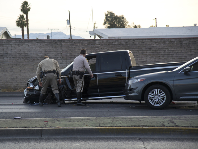 Officers inspect a vehicle at the scene of an accident involving at least six vehicles just north of the Washington Avenue and Rancho Drive intersection in Las Vegas on Tuesday, March 8, 2016. Dan ...