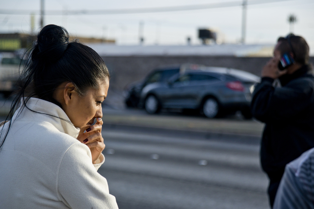 Lorena Ruiz waits on the sidewalk at the scene of an accident involving at least six vehicles just north of the Washington Avenue and Rancho Drive intersection in Las Vegas on Tuesday, March 8, 20 ...