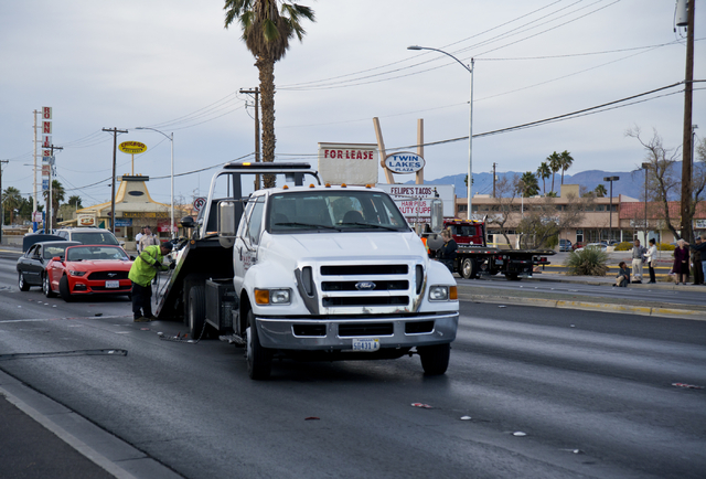 A vehicle is pulled onto a flatbed truck at the scene of an accident involving at least six vehicles just north of the Washington Avenue and Rancho Drive intersection in Las Vegas on Tuesday, Marc ...