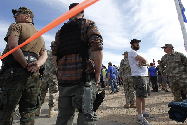 Armed supporters of the Bundy family gather outside of Bunkerville to challenge the BLM on April 12, 2014. (Jason Bean/Las Vegas Review-Journal)