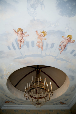 Liberace had commissioned a ceiling mural in the master bedroom and bath. The bath mural features cherubs, clouds and an image of Liberace. Additionally, a mirrored floor-to-ceiling fireplace is o ...