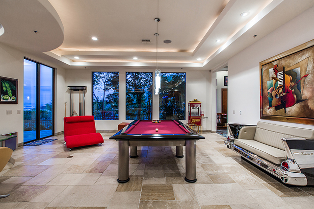 The game room has a unique couch that is styled after a classic car.( COURTESY OF Shapiro & Sher Group)