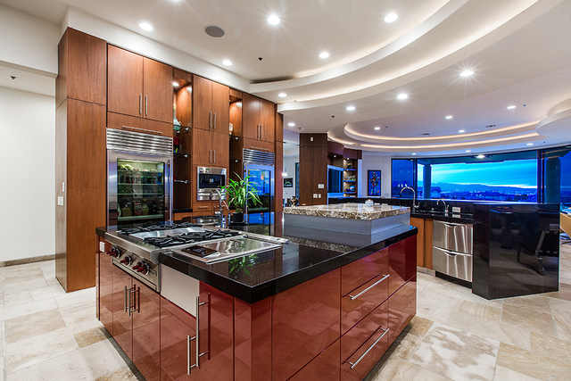 The kitchen is positioned to take in the views of the Las Vegas Valley. (COURTESY OF Shapiro & Sher Group)
