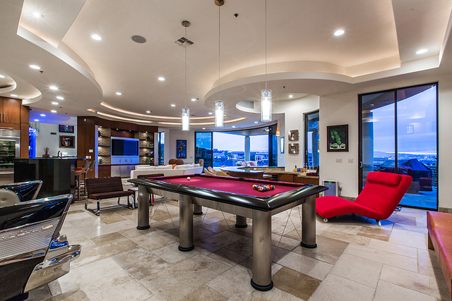 The game room has a pool table. (COURTESY OF Shapiro & Sher Group)