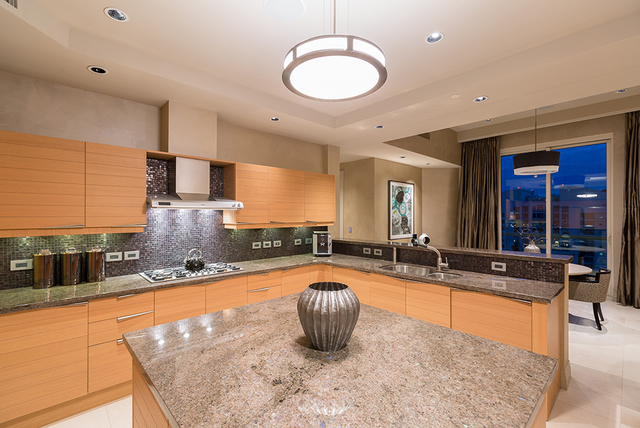 The stainless-steel Gagganeu appliances, custom cabinets, large pantry and granite countertops comprise the gourmet kitchen. (COURTESY SHAPIRO & SHER GROUP)