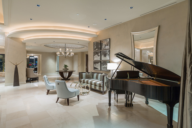 A Steinway concert grand piano epitomizes the room's rich ambiance. (COURTESY SHAPIRO & SHER GROUP)