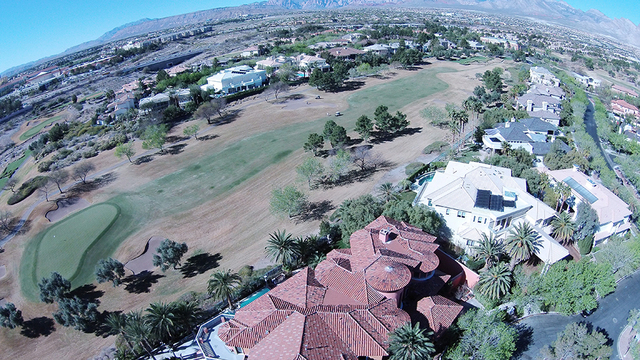 The Tournament Hills mansion sits on the golf course. (COURTESY TOM LOVE GROUP)