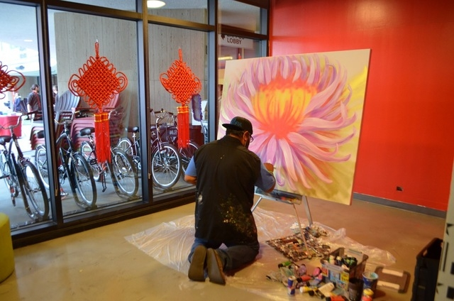 Miguel Hernandez, the full-time resident artist for Zappos, works on a pieces inside the company's downtown Las Vegas headquarters. Ginger Meurer/Special to View