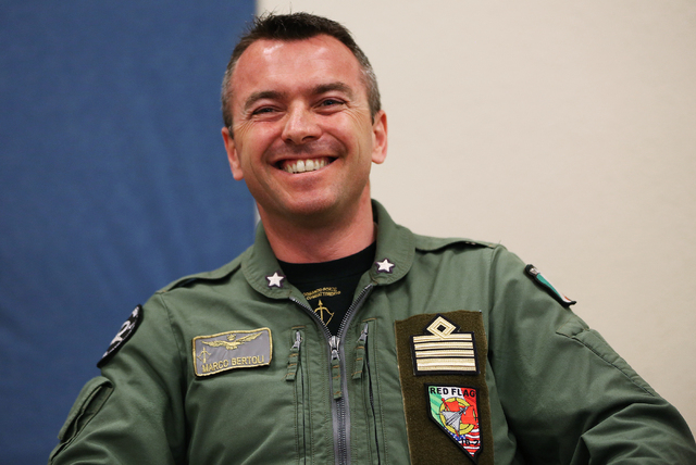 """Italian Air Force Col. Marco Bertoli shares a laugh with the media during the Red Flag air combat exercise at Nellis Air Force Base on Tuesday, March 8, 2016, in Las Vegas. """"This is by far one of  ..."""