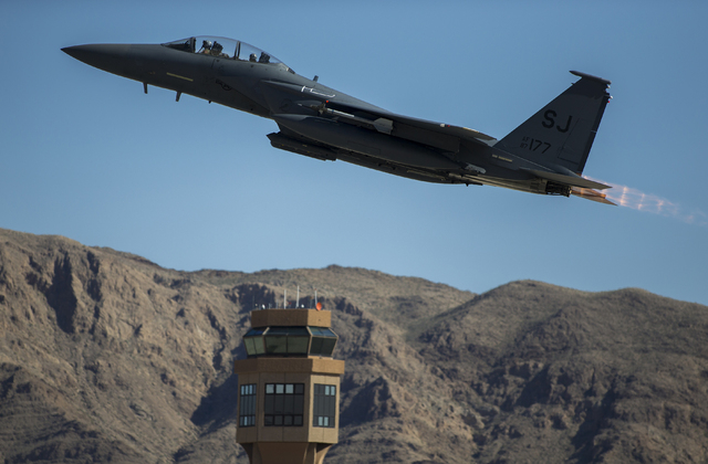 An F-15 passes a control tower during the Red Flag air combat exercise at Nellis Air Force Base on Tuesday, March 8, 2016, in Las Vegas. Benjamin Hager/Las Vegas Review-Journal @benjaminhphoto