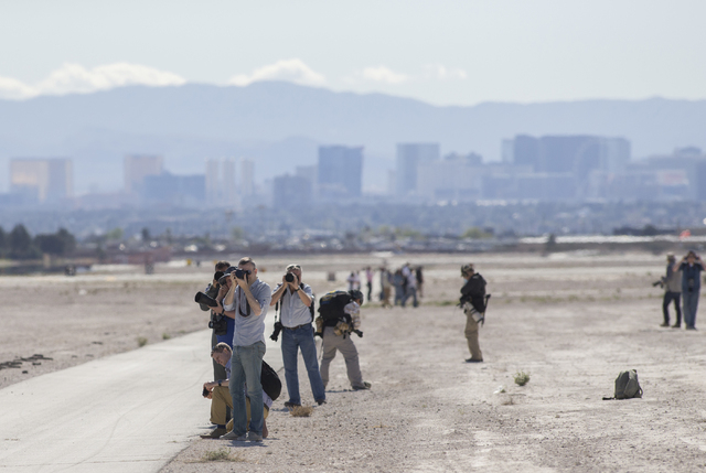Photographers line the runway to photograph a departing F-16 fighter jet during the Red Flag air combat exercise at Nellis Air Force Base on Tuesday, March 8, 2016, in Las Vegas.  Benjamin Hager/L ...