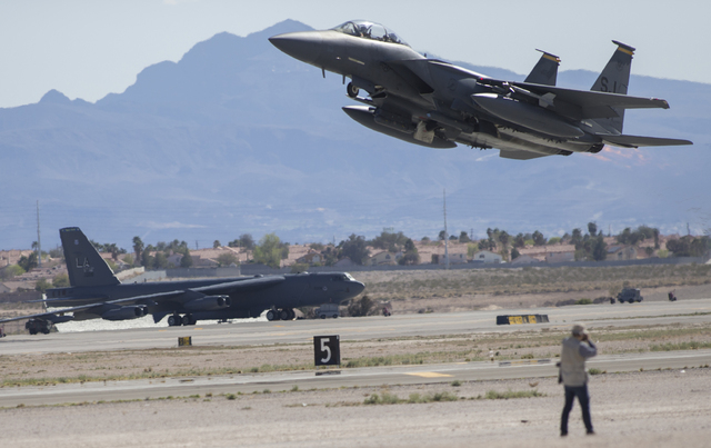 An F-16 takes off over a parked KC-135 Stratotanker during the Red Flag air combat exercise at Nellis Air Force Base on Tuesday, March 8, 2016, in Las Vegas. Benjamin Hager/Las Vegas Review-Journa ...