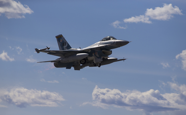 An F-16 from the Nellis 64th Aggressor Squadron passes the airstrip during the Red Flag air combat exercise at Nellis Air Force Base on Tuesday, March 8, 2016, in Las Vegas. Benjamin Hager/Las Veg ...