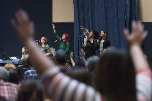 Members of the congregation worship as the band plays in the temporary sanctuary/gymnasium at Calvary Chapel Spring Valley at 7175 W. Oquendo Road in Las Vegas Sunday, Feb. 28, 2016. Jason Ogulnik ...