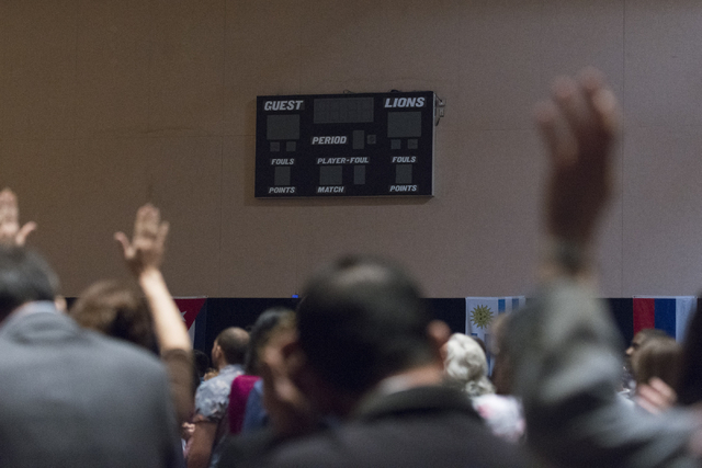 Members of the congregation worship in the temporary sanctuary/gymnasium at Calvary Chapel Spring Valley at 7175 W. Oquendo Road in Las Vegas Sunday, Feb. 28, 2016. Jason Ogulnik/Las Vegas Review- ...