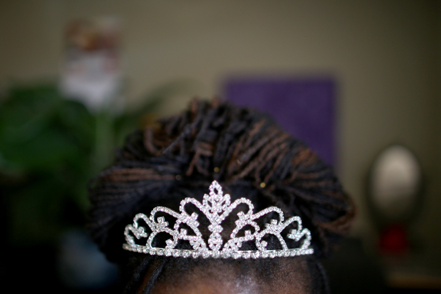 Lateefa Starks  wears a tiara while working on her homework at her home Wednesday, March 9, 2016. She's worn a tiara every day since she was released from prison. Rachel Aston/las Vegas Review-Jou ...
