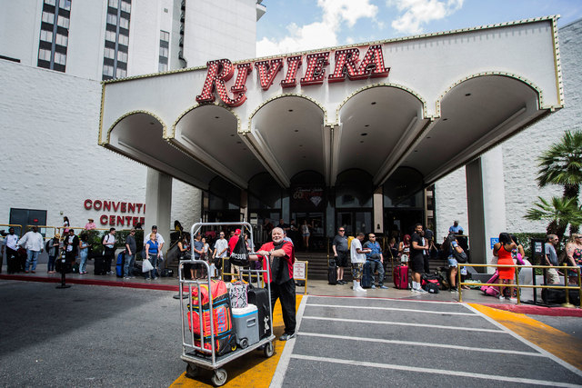 People wait for rides after checking out of the Riviera hotel-casino, 2901 Las Vegas Blvd. South,  on Monday, May 4, 2015. The casino closed Monday after 60 years on the Las Vegas Strip. (Jeff Sch ...