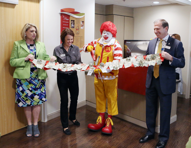 Alyson McCarthy, executive director at Ronald McDonald House, left, Kellie Vander Veur, board member at Ronald McDonald House, second left, Ronald McDonald, second right, and Todd Sklamberg, CEO,  ...