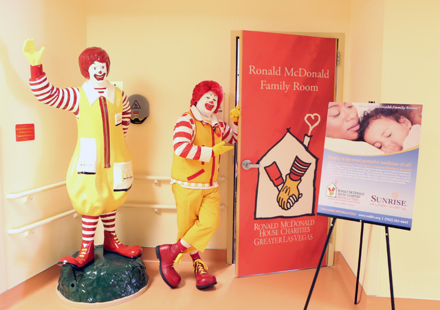 Ronald McDonald opens the door as he poses for a photo after participating in a ribbon cutting ceremony during the grand opening of Las Vegas' first and only Ronald McDonald Family Room at Sunrise ...