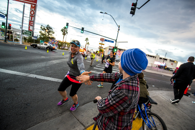 A young boy high fives runners in downtown Las Vegas during the Rock-n-Roll Marathon on Sunday, Nov. 15, 2015. Joshua Dahl/Las Vegas Review-Journal