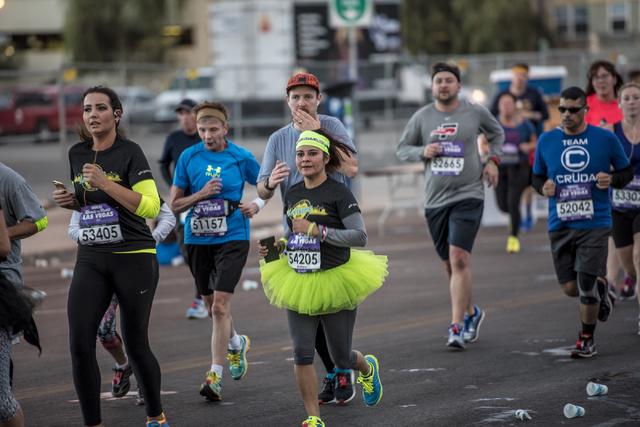 A runner wearing a tutu runs through downtown Las Vegas during the Rock-n-Roll Marathon on Sunday, Nov. 15, 2015. Joshua Dahl/Las Vegas Review-Journal