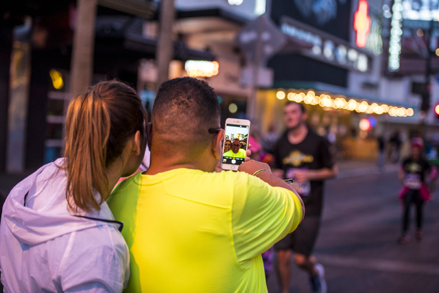A couple stops to take a selfie in downtown Las Vegas during the Rock-n-Roll Marathon on Sunday, Nov. 15, 2015. Joshua Dahl/Las Vegas Review-Journal