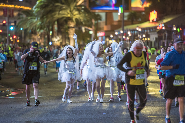Runners are dressed up in wedding veils on Las Vegas Blvd during the Rock-n-Roll Marathon in Las Vegas on Sunday, Nov. 15, 2015. Joshua Dahl/Las Vegas Review-Journal
