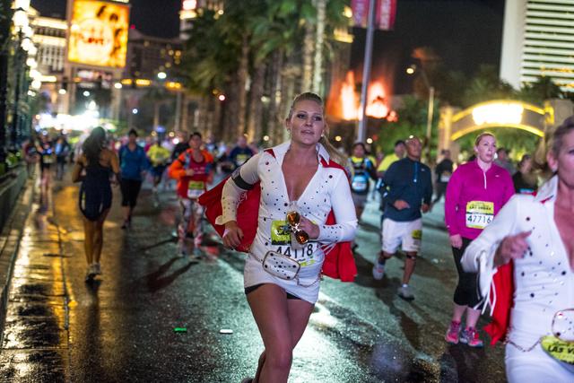 A runner dressed as Elvis runs on Las Vegas Blvd during the Rock-n-Roll Marathon in Las Vegas on Sunday, Nov. 15, 2015. Joshua Dahl/Las Vegas Review-Journal