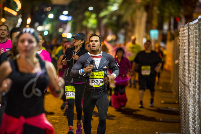 A runner is seen dressed in a tuxedo body suit on Las Vegas Blvd during the Rock-n-Roll Marathon in Las Vegas on Sunday, Nov. 15, 2015. Joshua Dahl/Las Vegas Review-Journal