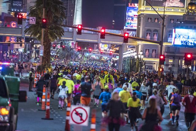 Runners make their way down Las Vegas Blvd during the Rock-n-Roll Marathon in Las Vegas on Sunday, Nov. 15, 2015. Joshua Dahl/Las Vegas Review-Journal