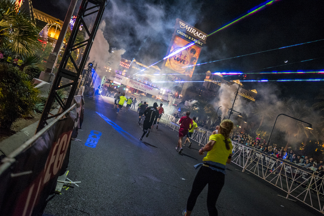 Runners head to the finish line on Las Vegas Blvd during the Rock-n-Roll Marathon in Las Vegas on Sunday, Nov. 15, 2015. Joshua Dahl/Las Vegas Review-Journal