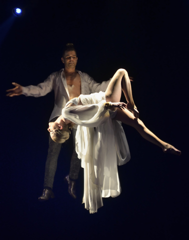 """Jan Rouven, background, and dancer Sarah Vose appear to float during """"Illusions"""" at the Tropicana hotel-casino at 3801 Las Vegas Blvd. S. in Las Vegas on Wednesday, March 11, 201 ..."""