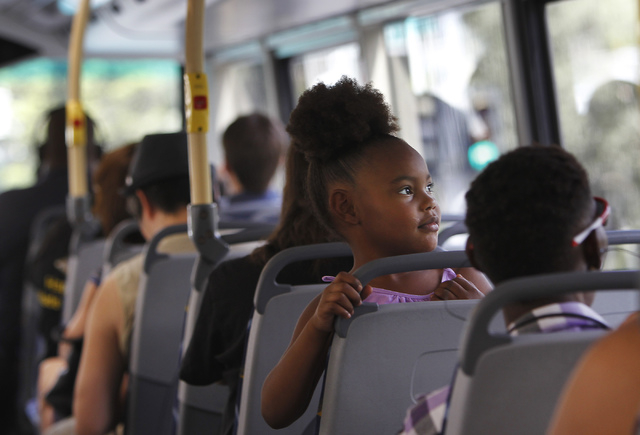 Five-year-old Promise Davis checks out the view while commuting on an RTC Transit bus with her family in Las Vegas on Wednesday, July 16, 2014. (Jason Bean/Las Vegas Review-Journal)