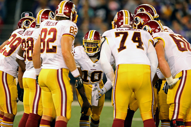 Aug 23, 2014; Baltimore, MD, USA; Washington Redskins quarterback Robert Griffin III leads the huddle against the Baltimore Ravens at M&T Bank Stadium. (Mitch Stringer-USA TODAY Sports)