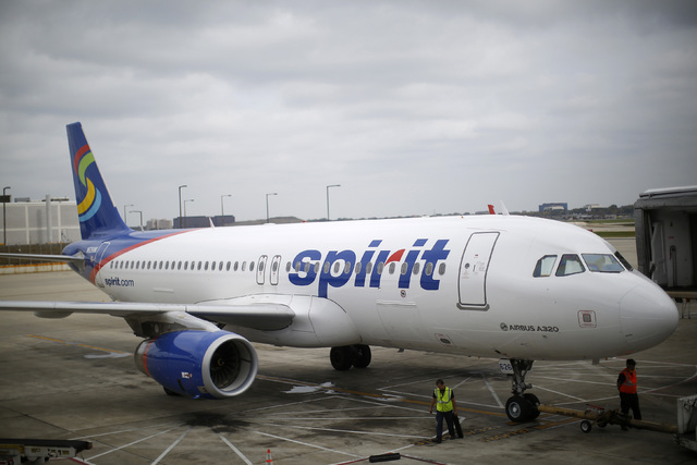 A Spirit Airlines airplane sits at a gate at the O'Hare Airport in Chicago, Illinois October 2, 2014. (Jim Young/Reuters)