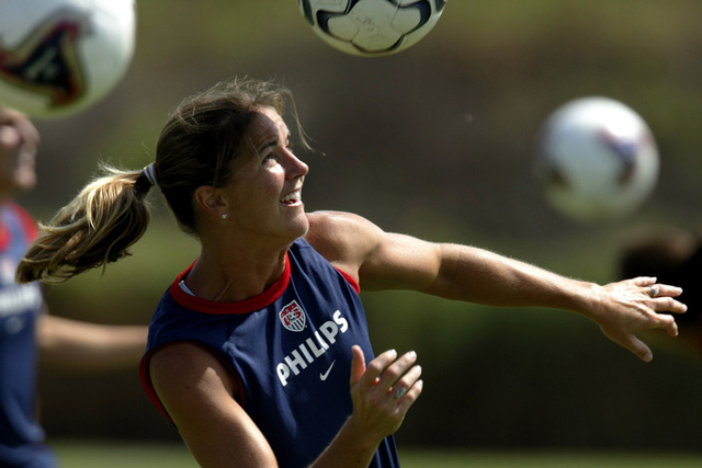 Brandi Chastain heads a ball as the United States women's national soccer team begins their training camp in San Diego, August 21, 2003 in defense of the 1999 World Cup title. (Mike Blake/Reuters)
