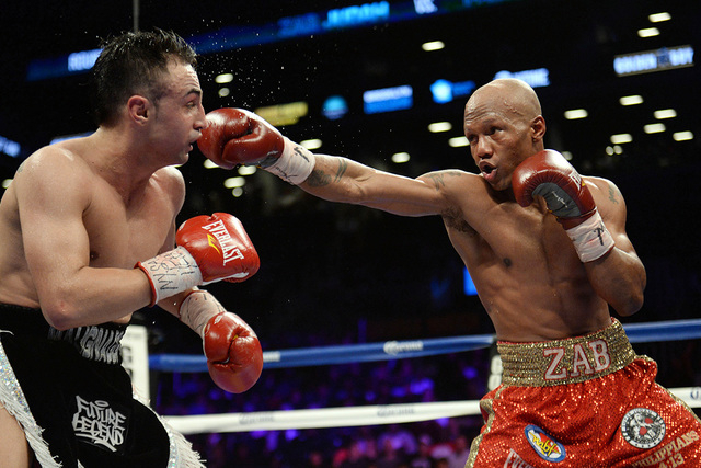 Dec 7, 2013; Brooklyn, NY, USA; Zab Judah (red trunks) and Paulie Malignaggi (black trunks) box during their NABF Welterweight Title bout at Barclays Center. Malignaggi won via unanimous decision. ...